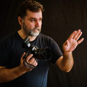 Harry Pocius photographer, directing a photo session